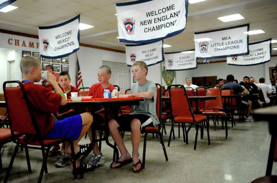 "Members of the Fairfield American Little League eat breakfast in the cafeteria in ""The Grove,"" the area where players and coaches live during the Little League World Series. The Grove features a pool, large recreation room, and dorms for players as well as the infirmary and laundry facilities. Photo: Lindsay Niegelberg / Connecticut Post"
