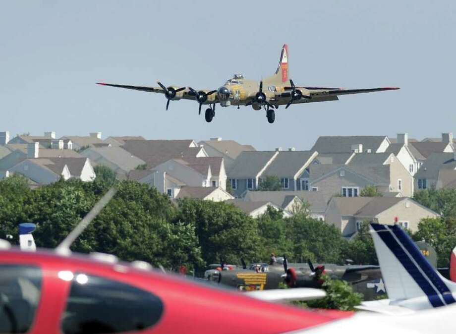 A B-17 Flying Fortress lands during the annual Wings of Freedom Tour of  World War II vintage war planes at Westchester County Airport, White Plains, N.Y., Friday afternoon, Aug. 20, 2010. Photo: Bob Luckey / Greenwich Time