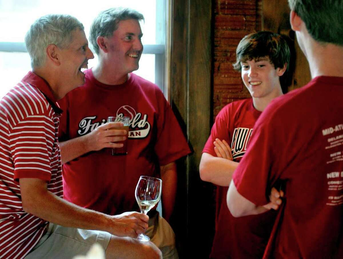 Fairfield American coach Chris Daley, left, chats with family and friends during a gathering for the team and supporters at the Bullfrog Brewery in Williamsport, Penn., after the New England Champions defeated the Northwest in their game Friday, August 20, 2010.