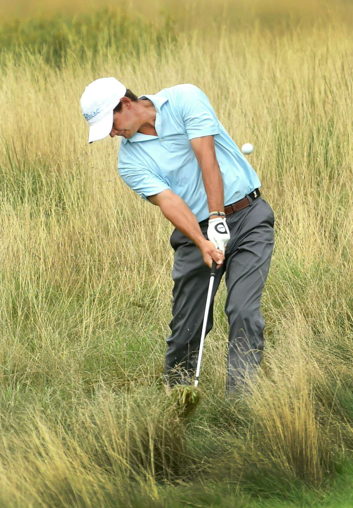 Hamden, Connecticut - Wednesday, August 1, 2018: Runner-up C.J. Swift of New Canaan punches out of the tall grass on the 18th fairway during the final round of the Connecticut Open Golf Tournament Wednesday at the New Haven Country Club in Hamden. John VanderLaan of Southbury won the tournament.