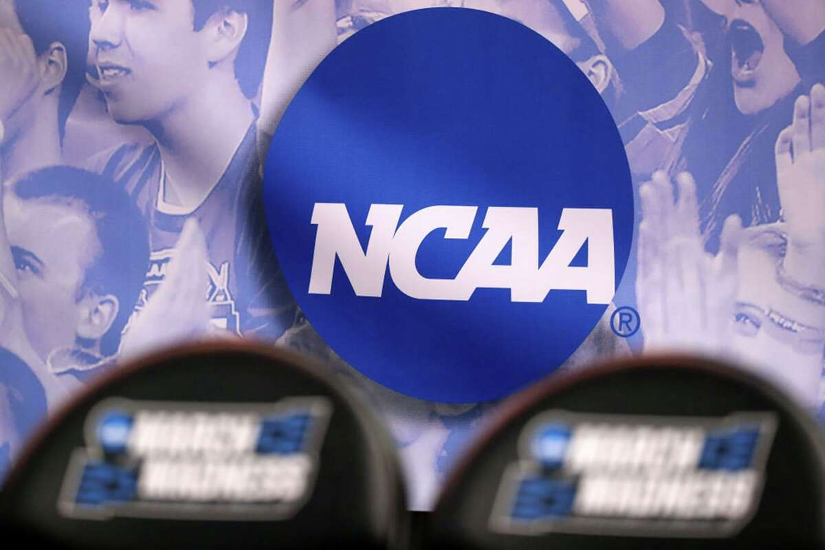 The NCAA logo is seen during the 2017 men's basketball tournament in Salt Lake City.