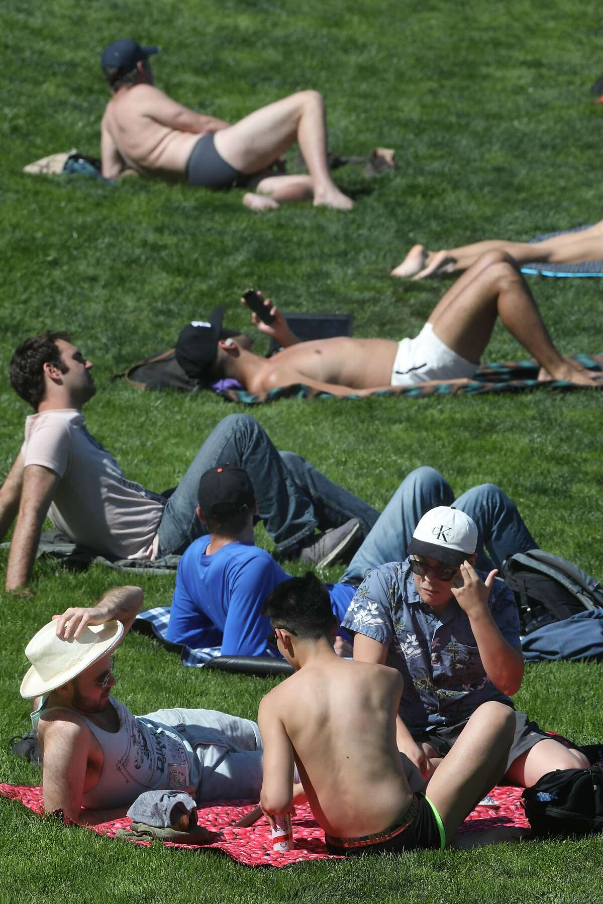 Sunbathers seen at Dolores park today on Tuesday, April 14, 2020, in San Francisco, Calif.