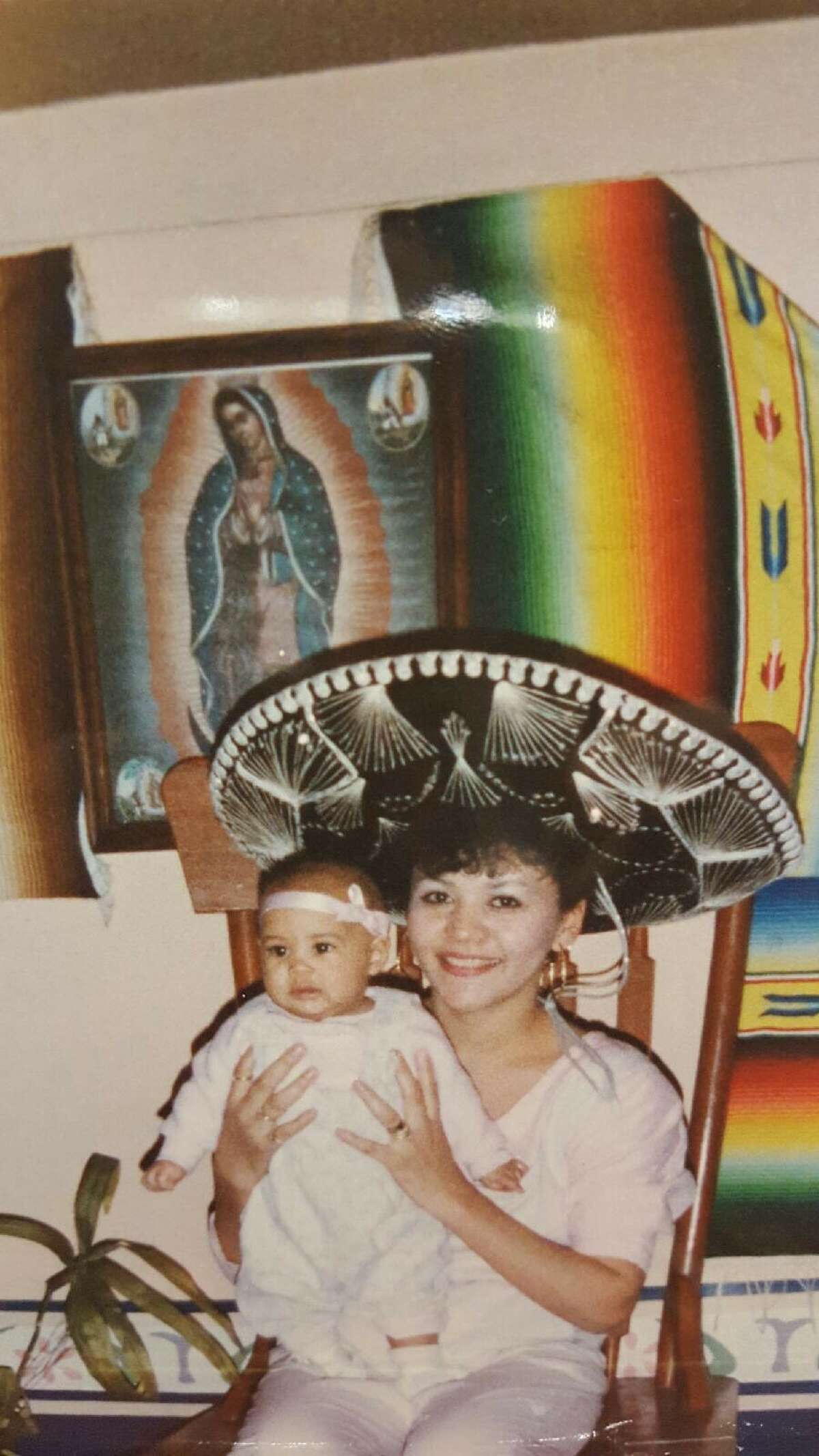 Reyes is pictured here with her grandmother in a restaurant in Monterrey, Mexico.