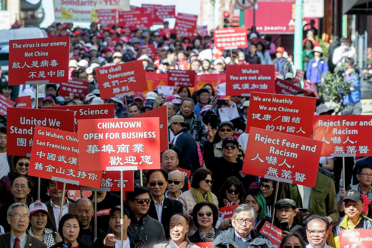 More than 1,500 Asian Americans across the U.S. reported discrimination related to COVID-19 in the past month, according to advocates who launched a reporting tool to track hate incidents against Asians. In this file photo, hundreds of people took to the streets on Feb. 29, 2020, to protest racism against the Chinese community during a march down Grant Avenue from Chinatown's Portsmouth Square to Union Square in San Francisco.