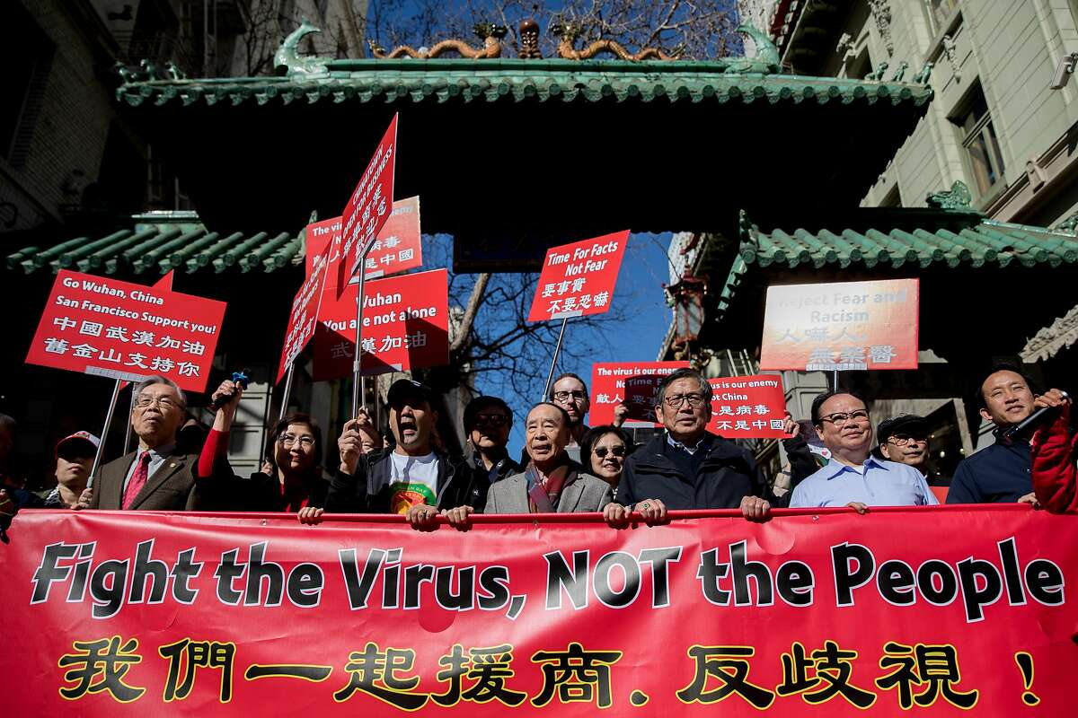 Hundreds of Chinatown residents along with local and state officials walk through the Dragon's Gate as they protest against racism in the Chinese community during a march down Grant Avenue from Chinatown's Portsmouth Square to Union Square in San Francisco, Calif. Saturday, February 29, 2020. Racism against the Chinese community has increased since the discovery of the first coronavirus outbreak in Wuhan, China has spread globally.