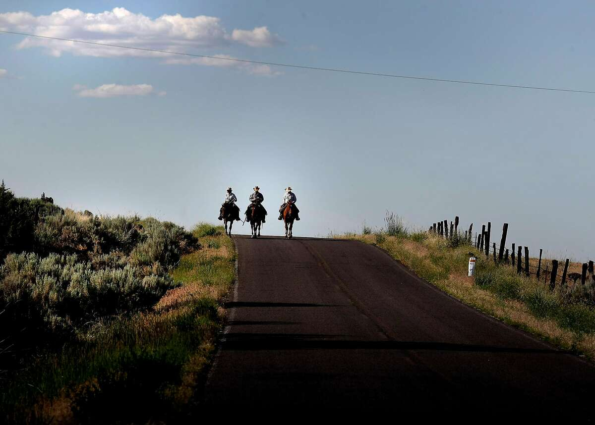 Members of the McGarva family ride down a country road near their home in Likely, CA to move some cattle to another pasture. Modoc County in the far northeastern corner of California is an interesting mix of Republican ranchers and progressive newcomers who seem to share a distrust of government and have an independent spirit.
