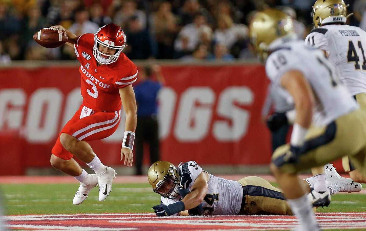 Clayton Tune, scrambling away from a tackle against Navy last year, is on solid footing as the QB1 for Houston going into the 2020 season.