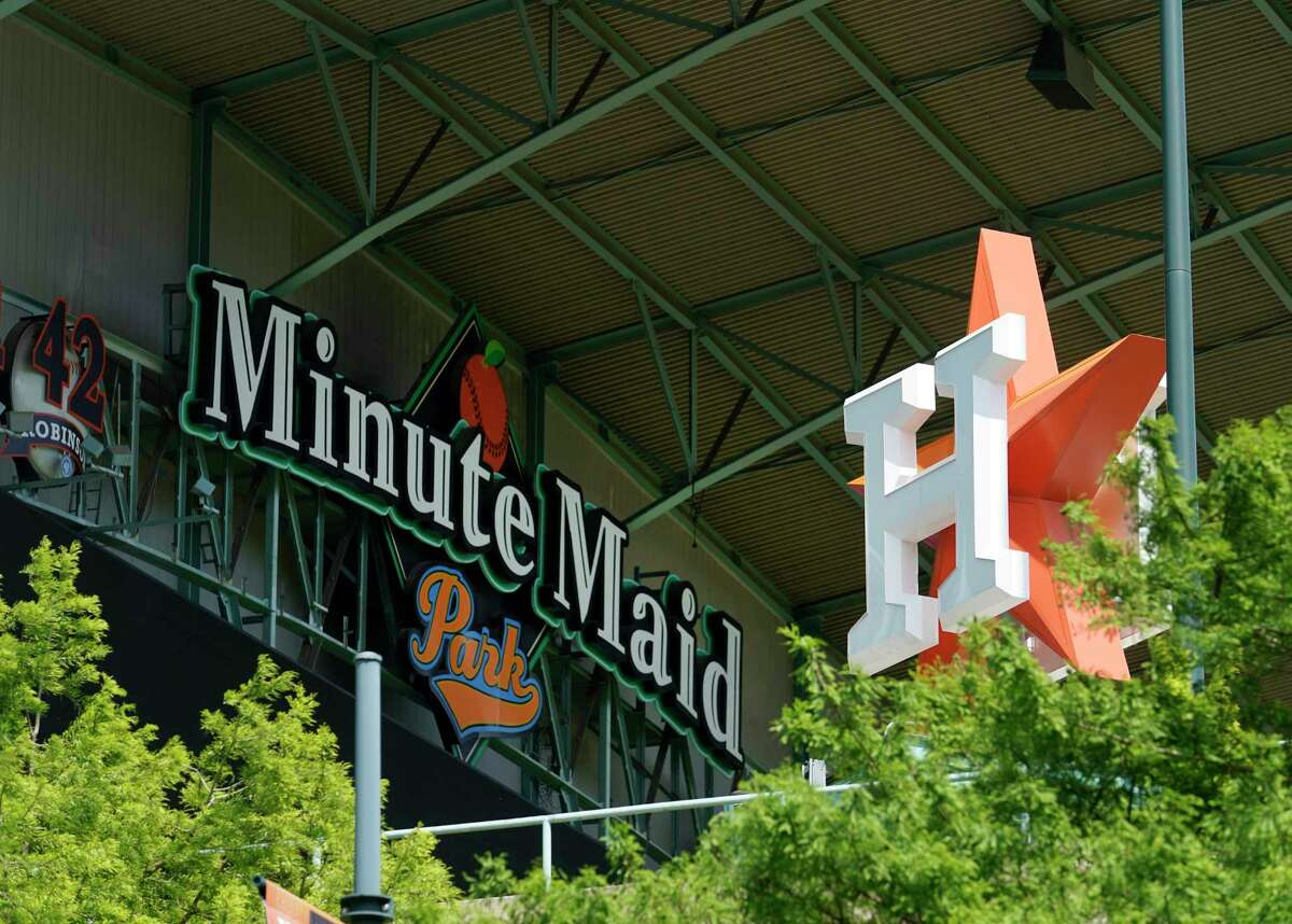 Houston Astros signs at Minute Maid Park are shown Wednesday, April 29, 2020, in Houston. Major League Baseball delayed the start of the season amid the Covid-19 pandemic.
