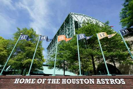 Houston Astros banners are displayed in the Plaza at Minute Maid Park Wednesday, April 29, 2020, in Houston. Major League Baseball delayed the start of the season amid the Covid-19 pandemic.
