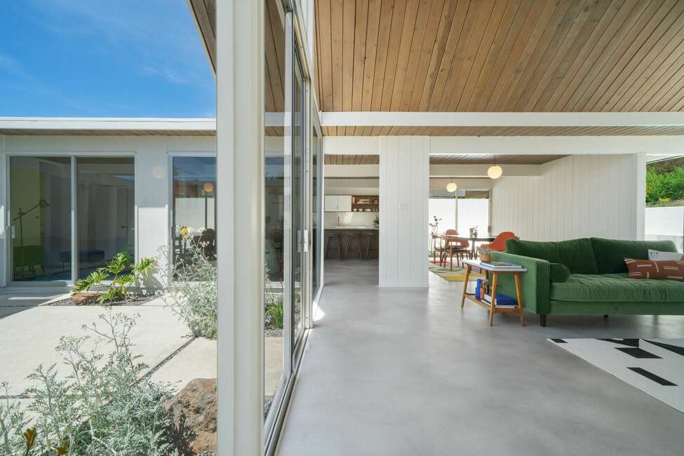 Only a thin sliver of glass separates the inside from the outside, a seamlessness that is a hallmark of mid-century and Eichler designs.