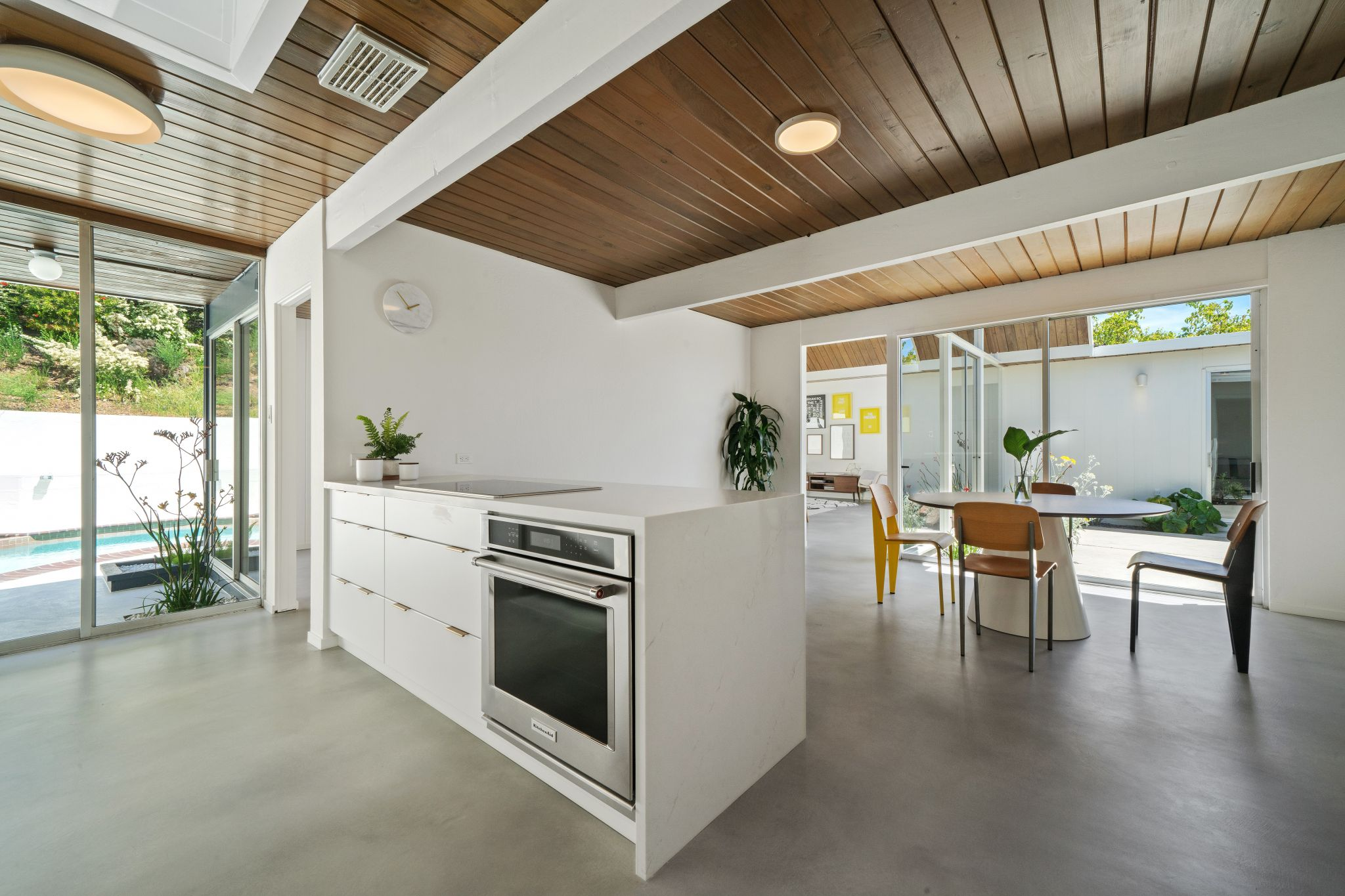 Unlike many 1960s homes, the kitchen here is totally open, flowing from one room to the next and from inside to outside.