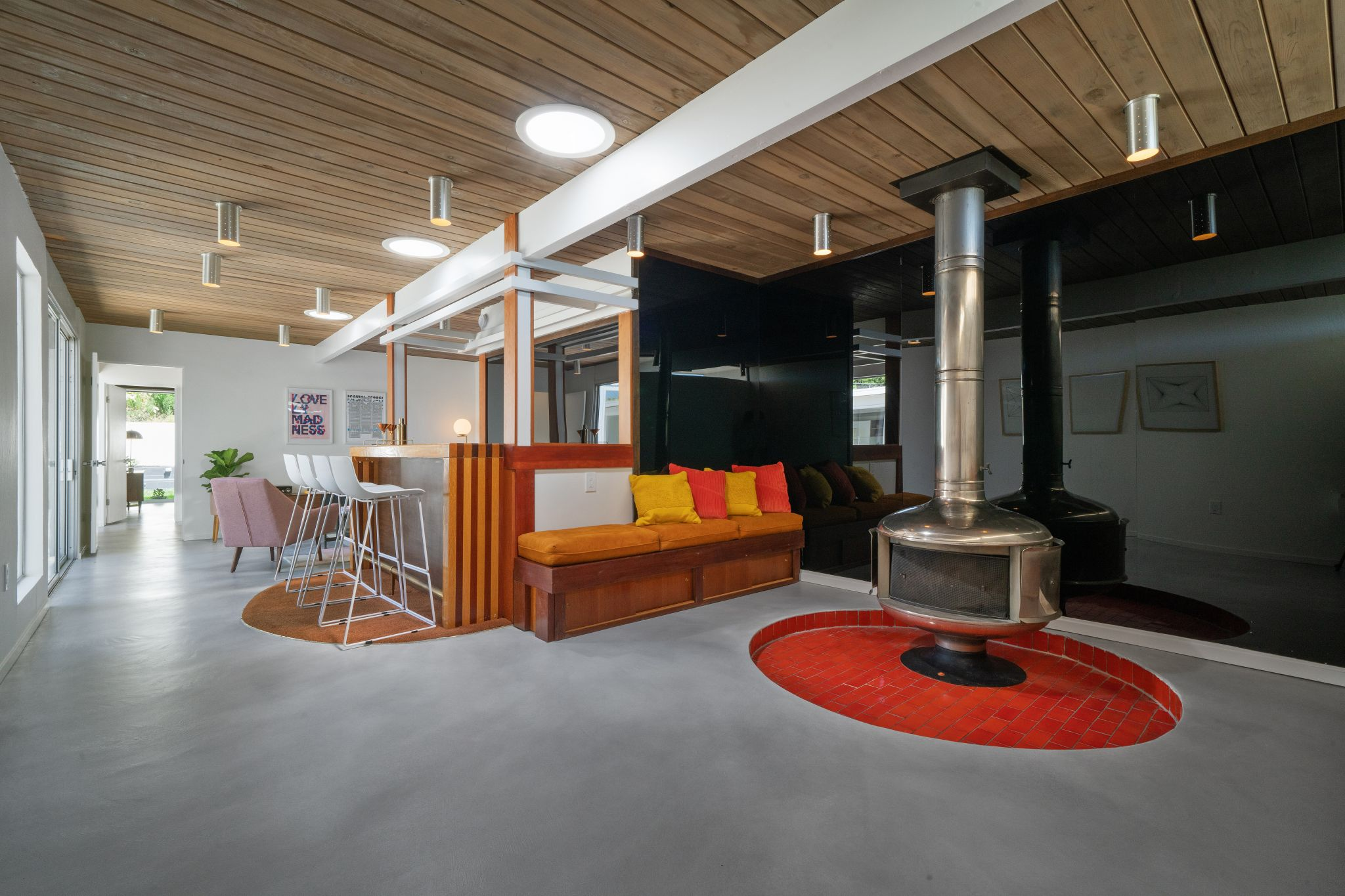 The property was originally built as a five-bedroom home. One bedroom and the garage have since been converted into an entertainment space with custom wet bar, sunken lounge area with built-in seating, a floating steel fireplace and period lighting throughout.