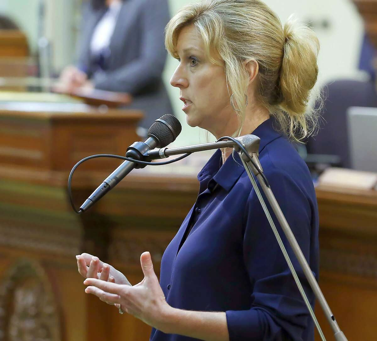 FILE - In this June 17, 2019, file photo, Assemblywoman Christy Smith, D-Santa Clarita, speaks in a session of the California Assembly in Sacramento, Calif. The fight for an open U.S. House seat in a swing district north of Los Angeles provides Republicans with a rare opportunity to gain ground in heavily Democratic California, and the outcome could send a message about where voters place their trust during the coronavirus crisis. The toss-up contest between Republican Mike Garcia and Democrat Smith will inevitably be seen as a proxy vote on President Donald Trump's leadership during the crisis. (AP Photo/Rich Pedroncelli, File)
