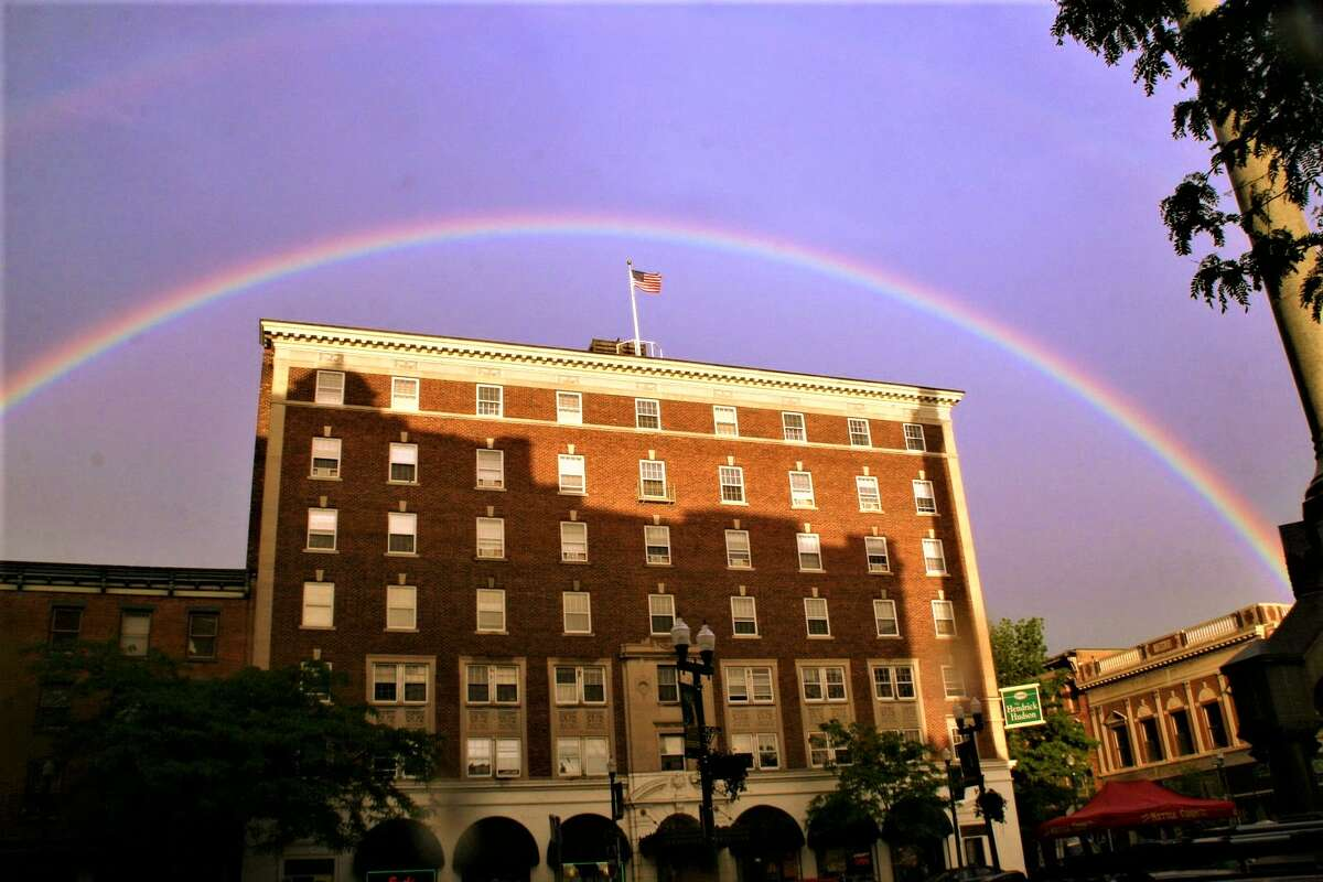 Don Bell of Troy captures a rainbow over the Hendrick Hudson hotel in Monument Square.