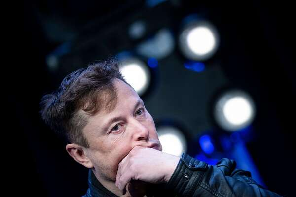 """(FILES) In this file photo Elon Musk, founder of SpaceX, listens to a question during the Satellite 2020 at the Washington Convention Center March 9, 2020, in Washington, DC. - Tesla chief Elon Musk on April 29 called the coronavirus confinement a """"fascist"""" action and """"an outrage"""" that infringes on personal freedom and will damage the economy. (Photo by Brendan Smialowski / AFP) (Photo by BRENDAN SMIALOWSKI/AFP via Getty Images)"""