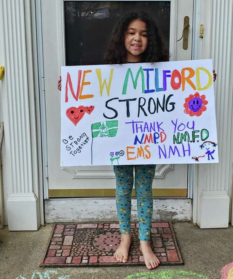 Sophia Gillece, 7, of New Milford, made cards for New Milford Hospital doctors and nurses who are working during the coronavirus pandemic. She also made a sign for her front yard. Photo: Courtesy Of The Gillece Family / Danbury News Times