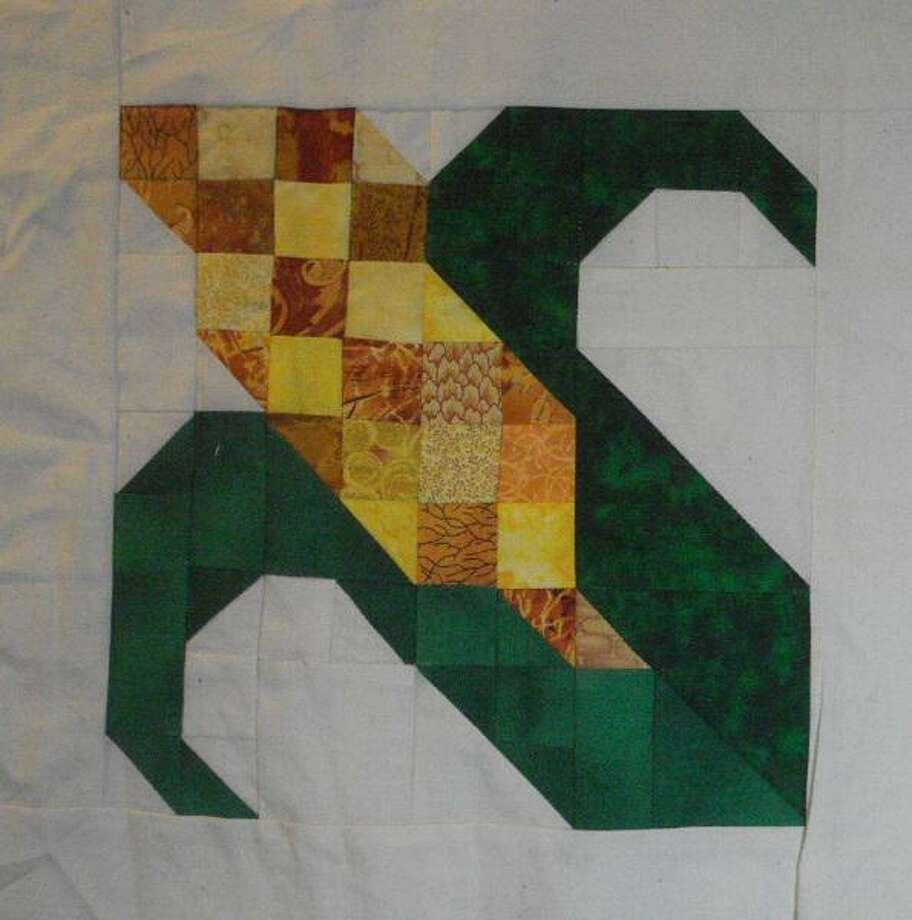 One of the new patterns to be showcased as part of the New Milford Barn Quilt Trail is the corn pattern, to be displayed at the Larson Barn at New Milford High School. The barn, built in 1900 as a dairy barn by Frank Larson, was later used for agriculture. Starting in 1957, the Larsons were known for their sweet corn, which they sold at a farm stand along Route 7. Photo: Courtesy Of New Milford Barn Quilt Trail Committee / Danbury News Times Contributed