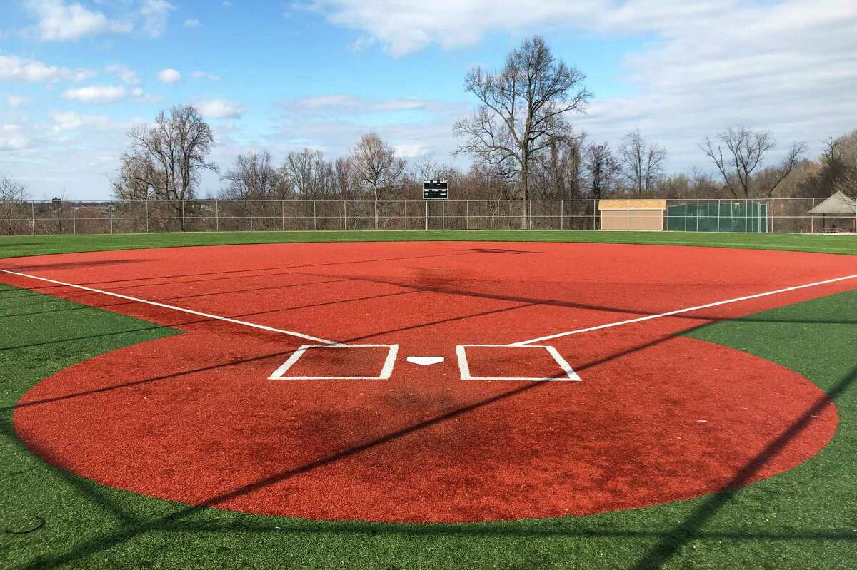 FILE - In this April 4, 2020, file photo, a youth baseball field sits empty at Monroeville Park in Monroeville, Pa. Doctors, scientists and sports leaders are outlining the path back to playing fields for children in grassroots sports -- an exercise that could inform major organizations on how to get their industries up and running as well in the midst of the COVID-19 pandemic. (AP Photo/Will Graves, File)