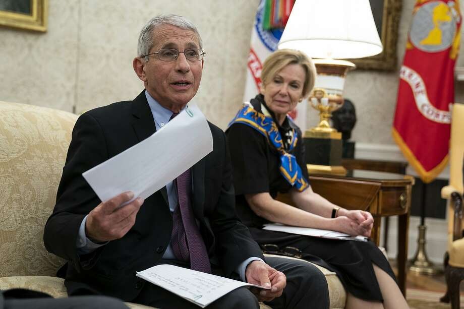 White House coronavirus response coordinator Dr. Deborah Birx listens as director of the National Institute of Allergy and Infectious Diseases Dr. Anthony Fauci speaks during a meeting between President Donald Trump and Gov. John Bel Edwards, D-La., about the coronavirus response, in the Oval Office of the White House, Wednesday, April 29, 2020, in Washington. (AP Photo/Evan Vucci) Photo: Evan Vucci / Associated Press