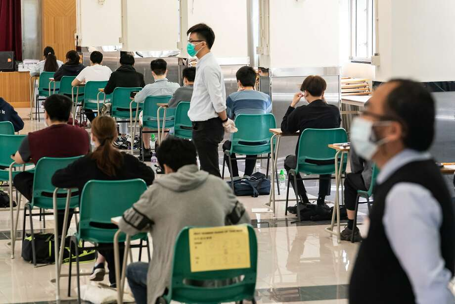 Students sit at a Diploma of Secondary Education (DSE) exams on April 29, 2020 in Hong Kong, China. Temperature checks and social distancing measures to avoid the spread of COVID-19 have have been put in place in the schools for over 50,000 candidates who will sit for the DSE examination this year. (Photo by Anthony Kwan/Getty Images) Photo: Anthony Kwan, Getty Images