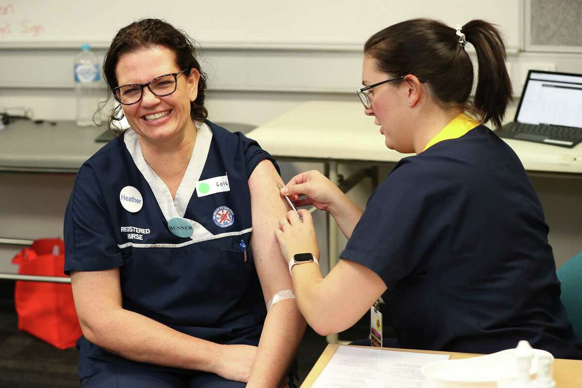 PERTH, AUSTRALIA - APRIL 20: Registered nurse Heather Hoppe receives a BCG injection in the trial clinic at Sir Charles Gairdner hospital on April 20, 2020 in Perth, Australia. Healthcare workers in Western Australia are participating in a new trial to test whether an existing tuberculosis vaccine can help reduce their chances of contracting COVID-19. 2000 frontline staff from Fiona Stanley, Sir Charles Gairdner and Perth Children's Hospital are taking part in the research trial, which will see half of participants receiving the existing Bacillus Calmette-Guérin (BCG) vaccine in addition to their flu vaccine, while the other half receive the regular flu shot. The BCG vaccine was originally developed to work against tuberculosis, but it is hoped it might help reduce the chance of contracting coronavirus as well as lessen the severity of symptoms and boost immunity in the long term. The BRACE trial is being led by by the Murdoch Children's Research Institute. (Photo by Paul Kane/Getty Images)