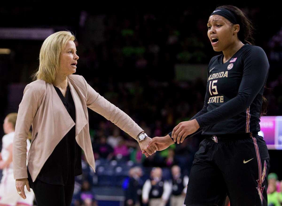 Florida State head coach Sue Semrau, left, greets player Kiah Gillespie on the sideline during a timeout in a game against Notre Dame on Feb. 10, 2019.