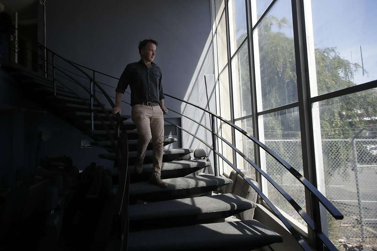 Sharky Laguana, president of the San Francisco Small Business Commission and owner of a van rental business, walks down a staircase at his office in San Francisco, Thursday, April 23, 2020. Unemployment is surging across the U.S. as small businesses struggle amid the coronavirus shutdown. Laguana says his van-rental firm Bandago has lost 99 percent of its business. (AP Photo/Jeff Chiu)