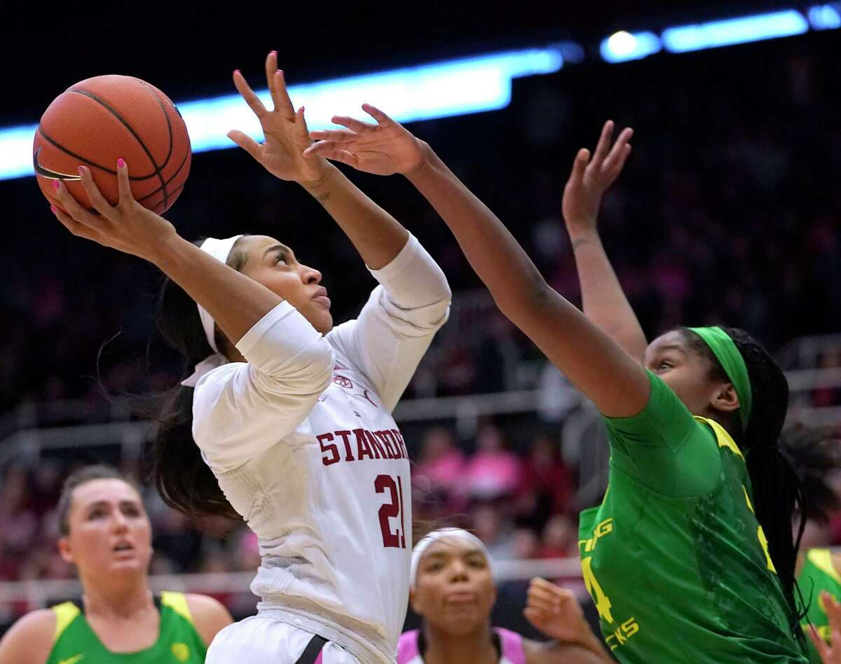 Stanford guard DiJonai Carrington (21) takes a shot over Oregon forward Ruthy Hebard (24) during the second half of an NCAA college basketball game Sunday, Feb. 10, 2019, in Stanford, Calif. Oregon won 88-48. (AP Photo/Tony Avelar)