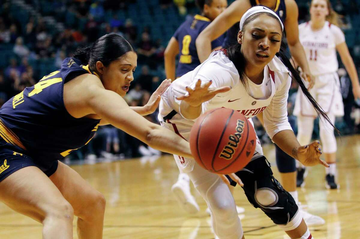 California's Recee' Caldwell, left, and Stanford's DiJonai Carrington scramble for the ball during the second half of an NCAA college basketball game at the Pac-12 women's tournament Friday, March 8, 2019, in Las Vegas. (AP Photo/John Locher)