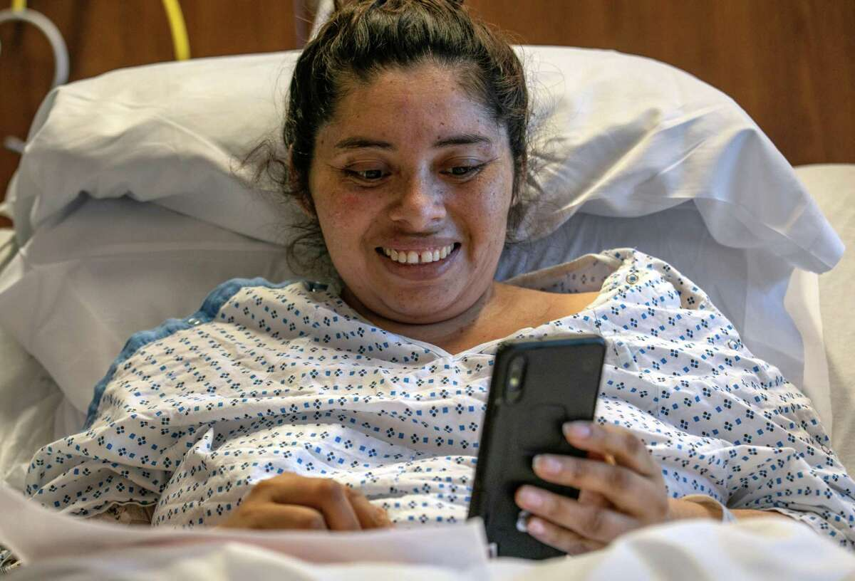 Coroniavirus patient and Guatemalan asylum seeker Zully makes a Zoom call with her husband and son, also recovering from coronavirus, days after being removed from a ventilator at a Stamford Hospital ICU on April 24, 2020 in Stamford, Connecticut. Weeks after giving birth to her son Neysel through an emergency C-section and put on a ventilator. Luciana Lira, 42, a teacher at Hart Magnet Elementary, became a temporary guardian for the newborn, after the boy's mother, Zully, went to the Stamford Hospital emergency room, almost eight months pregnant and sick with COVID-19.
