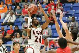 Wagner's Journee Phillips drives against Martin during a 5A regional semifinal game on March 6, 2020. Phillips committed to continue his career next season at TAMIU.