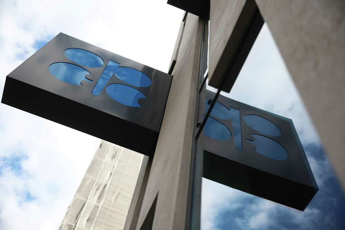 An OPEC sign hangs outside the OPEC Secretariat in Vienna.