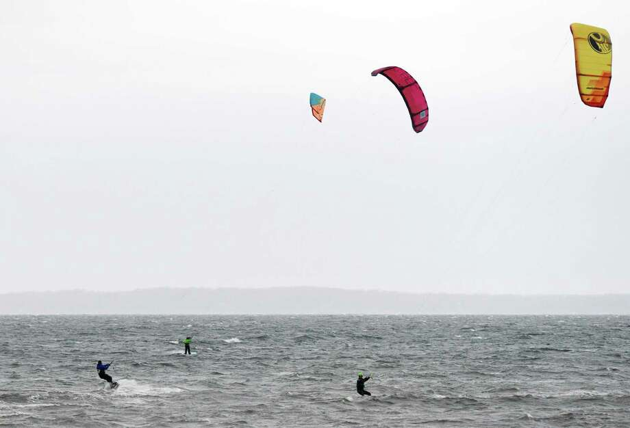Windsurfers surf in the Long Island Sound off shore from Lucas Point Beach in Old Greenwich, Conn. Sunday, April 26, 2020. Photo: Tyler Sizemore / Hearst Connecticut Media / Greenwich Time
