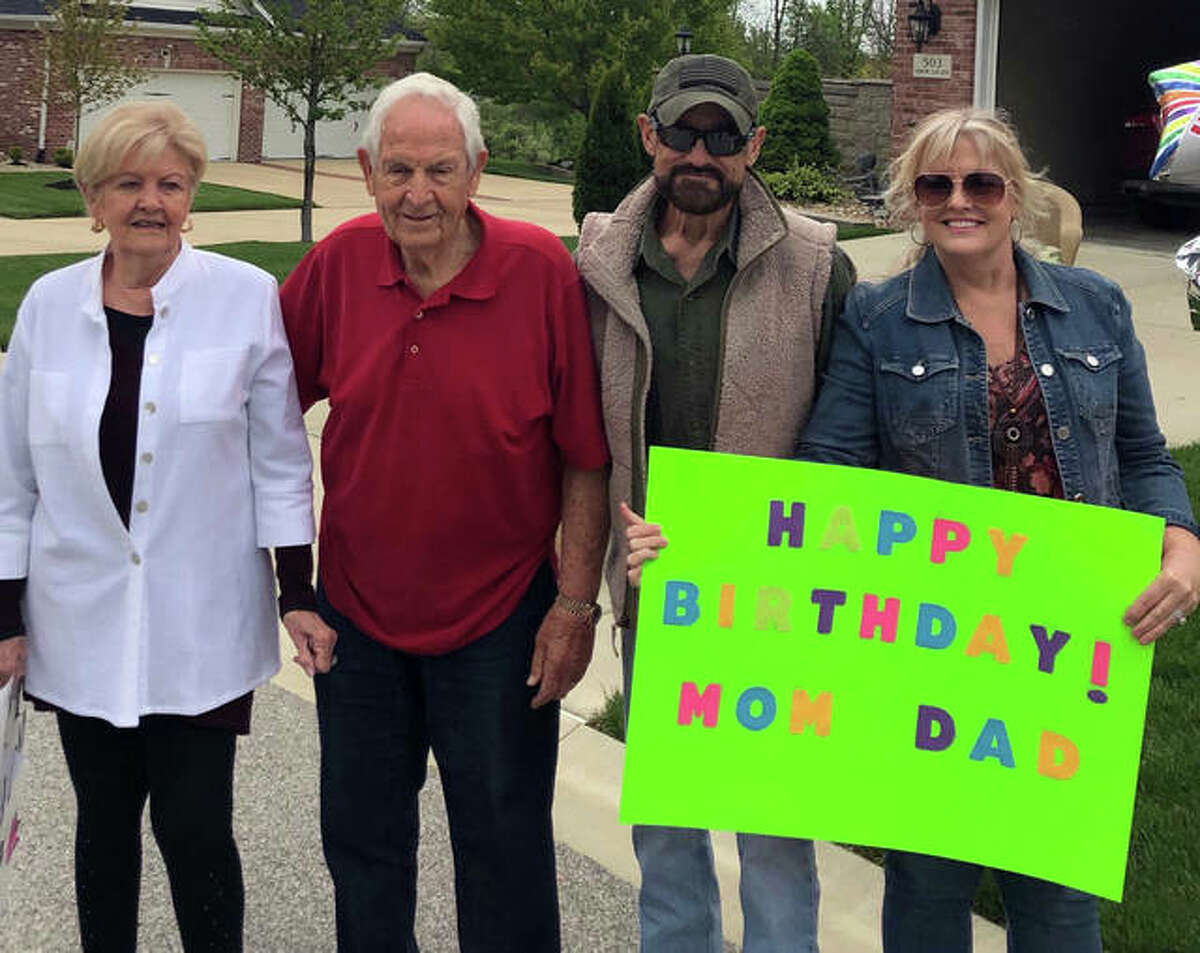 Left to right, Joan Flake, Dean Flake, son-in-law Bob Flake and daughter Tam Flake celebrate Joan and Dean's shared birthday on Monday. Joan turned 82 and Dean turned 83, and a parade of about 30 cars drove past the Traws' Edwardsville home to mark the occasion.