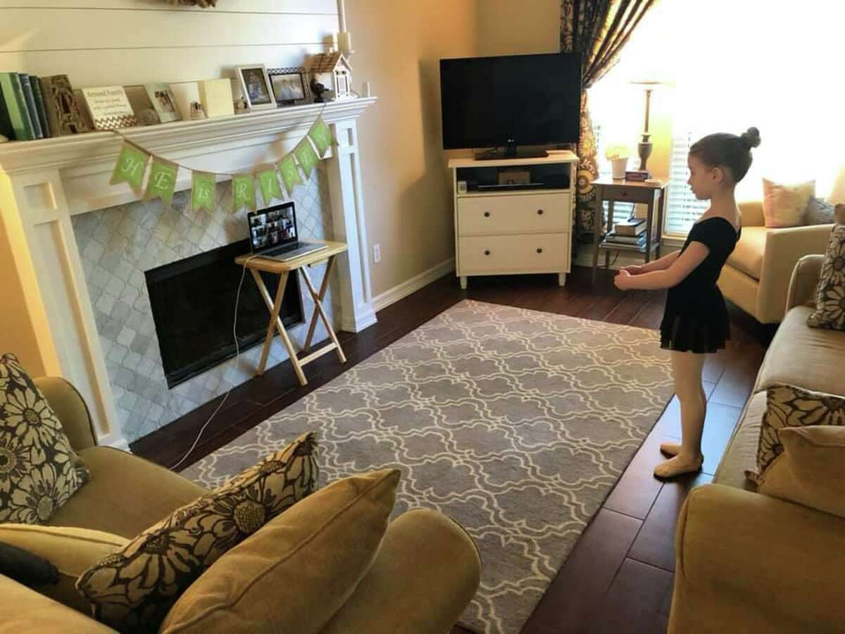 Anna Armond is all concentration as she prepares for a ballet routine through a Chara Christian Dance Academy virtual class.