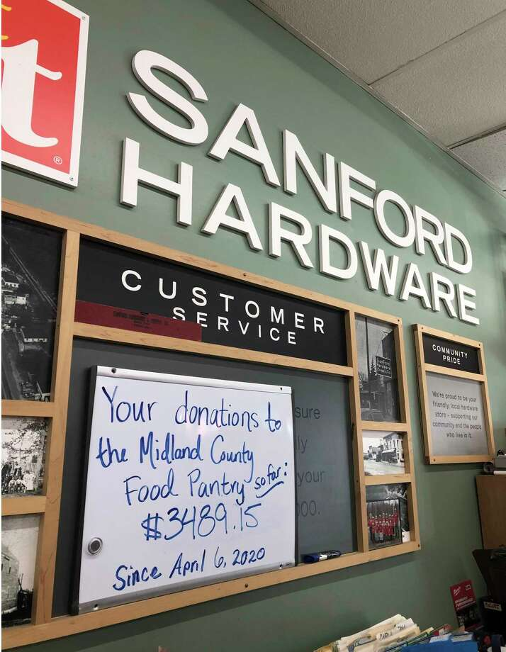 A whiteboard at Sanford Hardware, 346 Saginaw Road, shows the total amount raised so far by customers, to benefit the Midland County Emergency Food Pantry Network. (Photo provided)