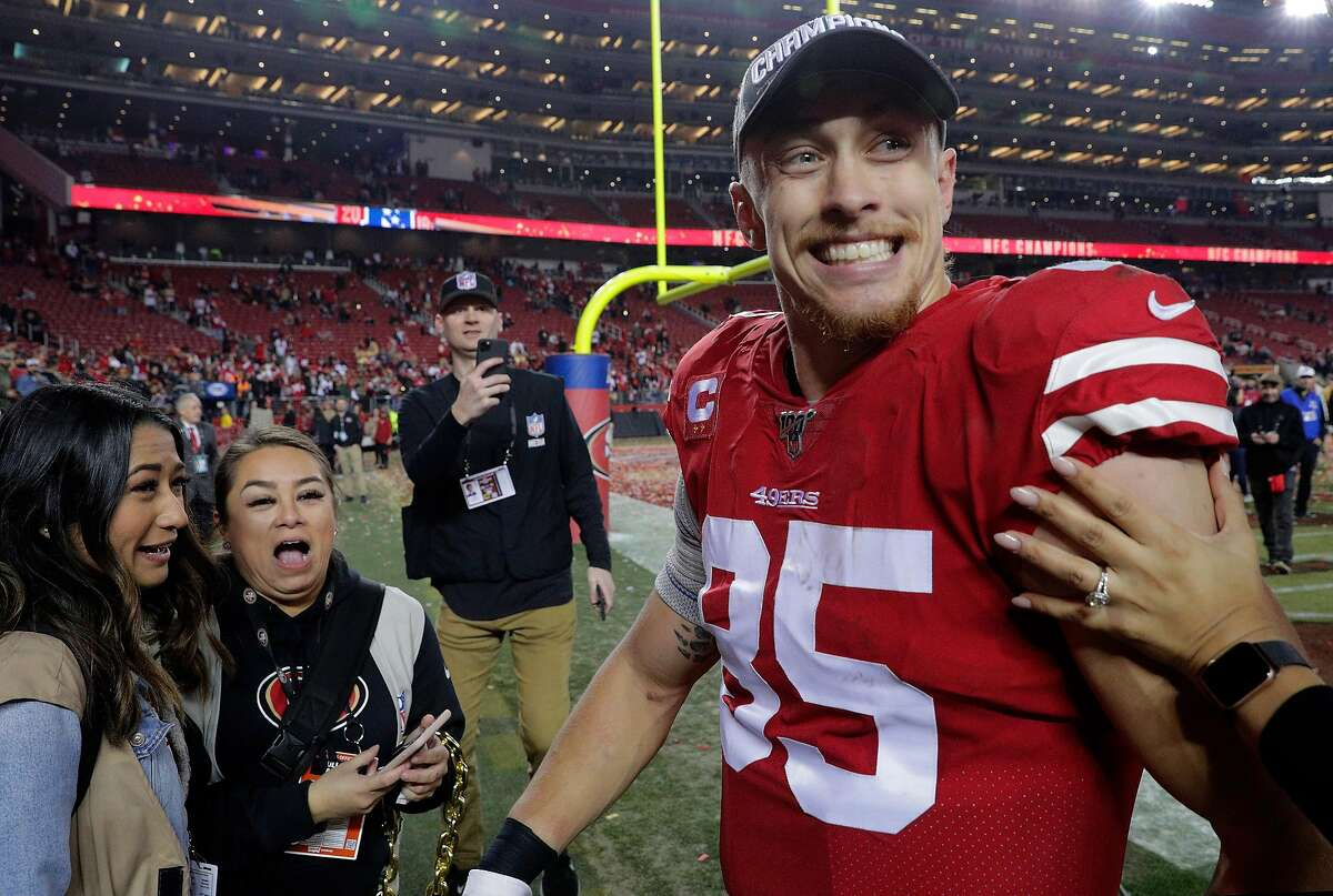 George Kittle smiles as he walk off the field after the San Francisco 49ers defeated the Green Bay Packers 37-20, in the NFC Championship Game at Levi's Stadium in Santa Clara , Calif., on Sunday, January 19, 2020. The 49ers will advance to play in Super Bowl LIV
