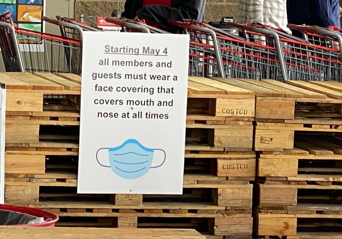 A face covering sign posted at the 4th Avenue Costco warehouse in Seattle, Washington on April 29, 20202. Starting on May 4, all guests