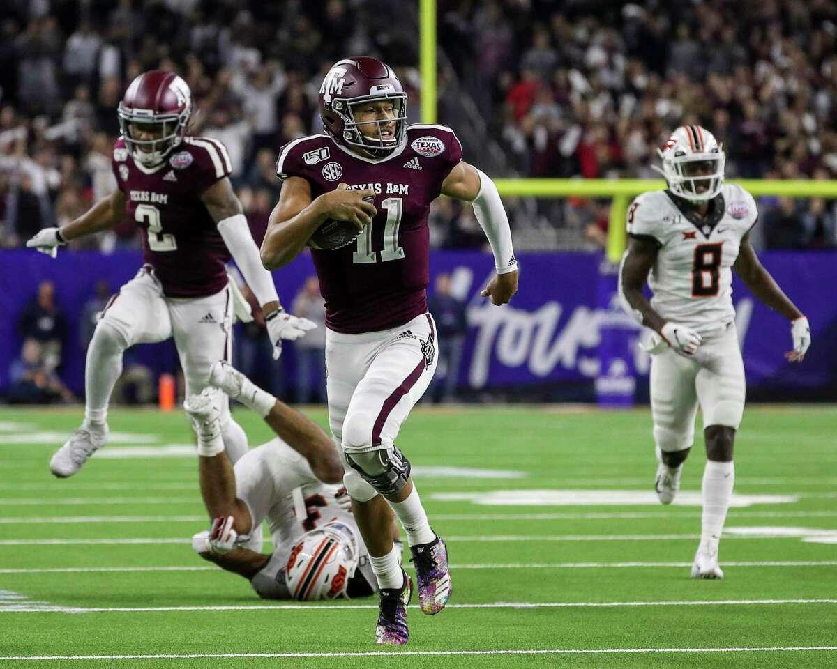 Texas A&M Aggies quarterback Kellen Mond (11) runs for a 67-yard touchdown run during the fourth quarter of the Texas Bowl at NRG Stadium on Friday, Dec. 27, 2019, in Houston.