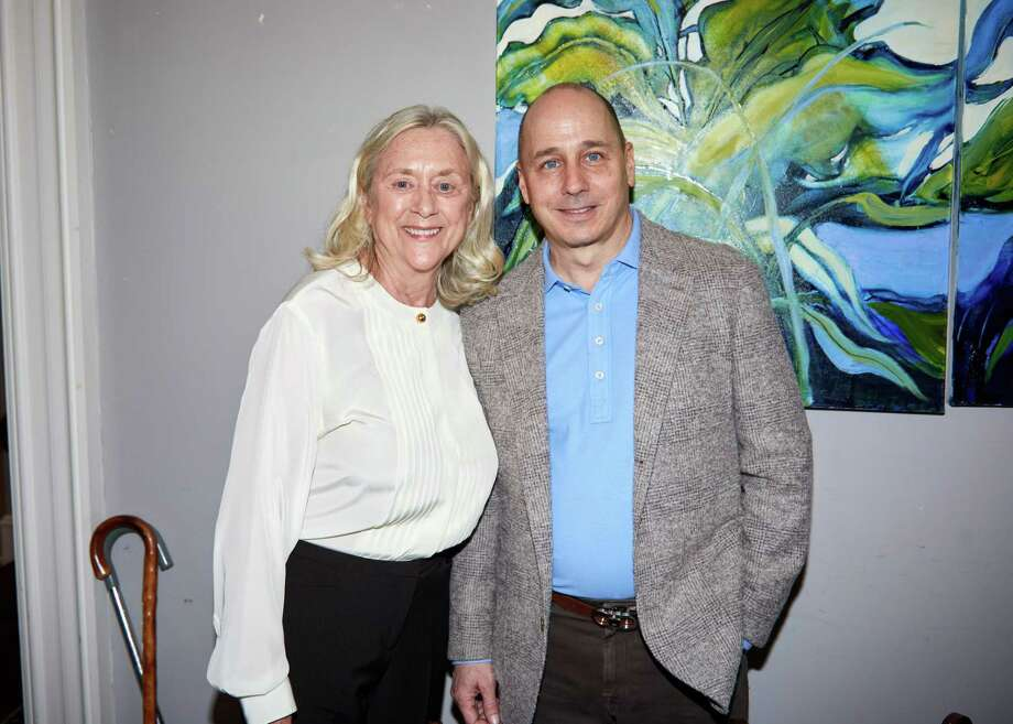 Barbara Marion of Greenwich and New York Yankees General Manager Brian Cashman at Family Centers benefit in Darien in 2019. Cashman will again be boosting Family Centers by taking part in a fundraising Zoom chat to talk Yankees baseball with fans and take questions. Photo: Contributed /