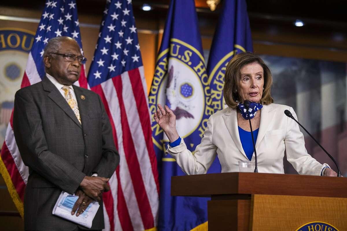 House Speaker Nancy Pelosi of Calif., with House Majority Whip James Clyburn of S.C., left, speaks during a news conference on Capitol Hill Thursday, April 30, 2020, in Washington. (AP Photo/Manuel Balce Ceneta)