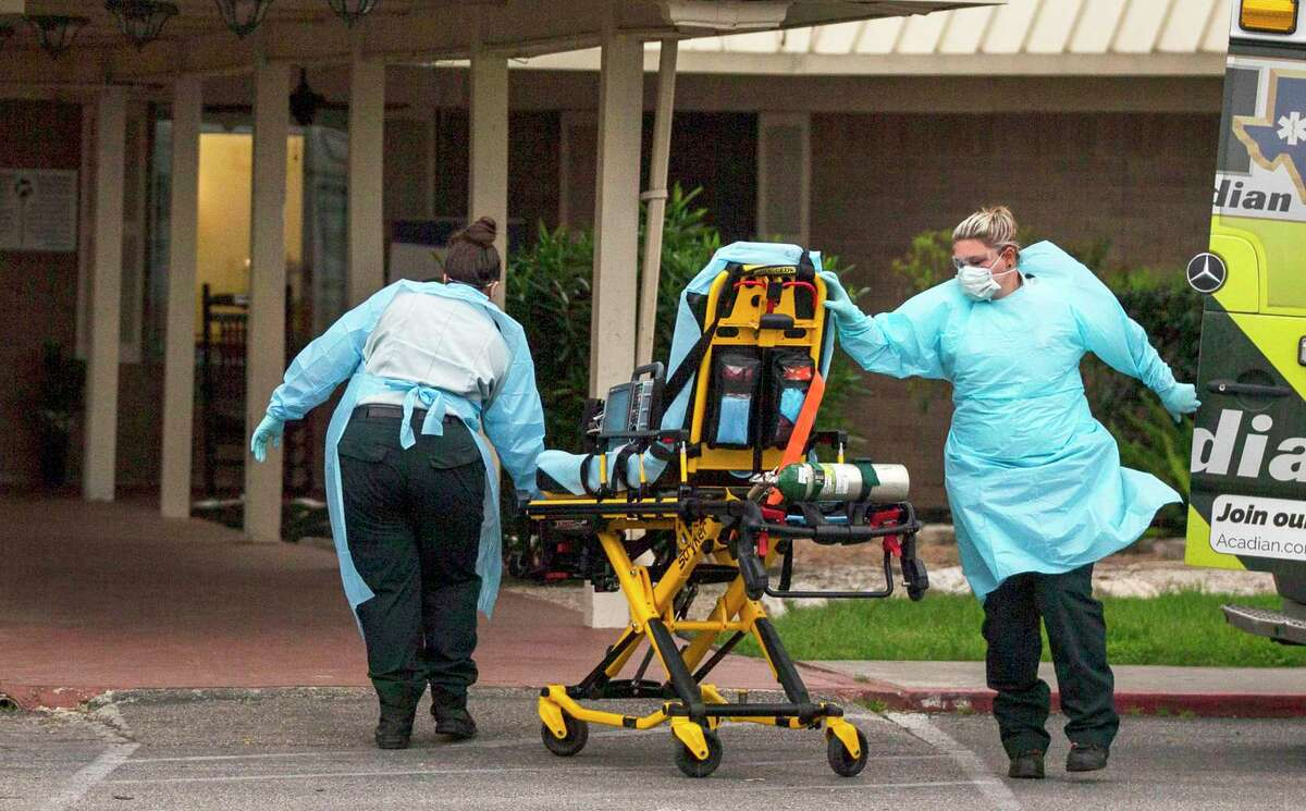 EMS personnel respond to a call at Southeast Nursing & Rehabilitation Center in San Antonio in early April. Nursing homes in Texas have been devastated by the coronavirus pandemic.