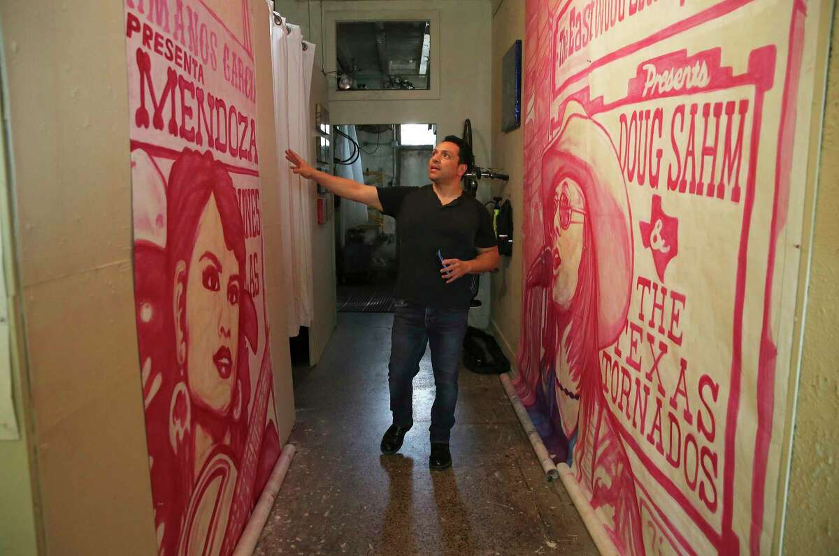 """Artist David Blancas is working in his studio to restore """"La Musica de San Anto,"""" a mural he painted 10 years ago that is showing some wear."""