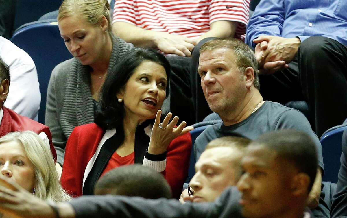 In this November 2019 file photo, University of Houston President Renu Khator talks with Tilman Fertitta, the Houston Rockets owner and chairman of the UH Board of Regents, during the second half an NCAA basketball game in Houston.