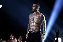 Maroon 5 is scheduled to rock New York's Citi Field, with guests Leon Bridges and Meghan Trainor June 25. But will the pandemic put a stop to this concert? Adam Levine, lead vocalist of Maroon 5, is seen here performing during the halftime show of Super Bowl LIII at Mercedes-Benz Stadium in Georgia, Feb. 3, 2019.