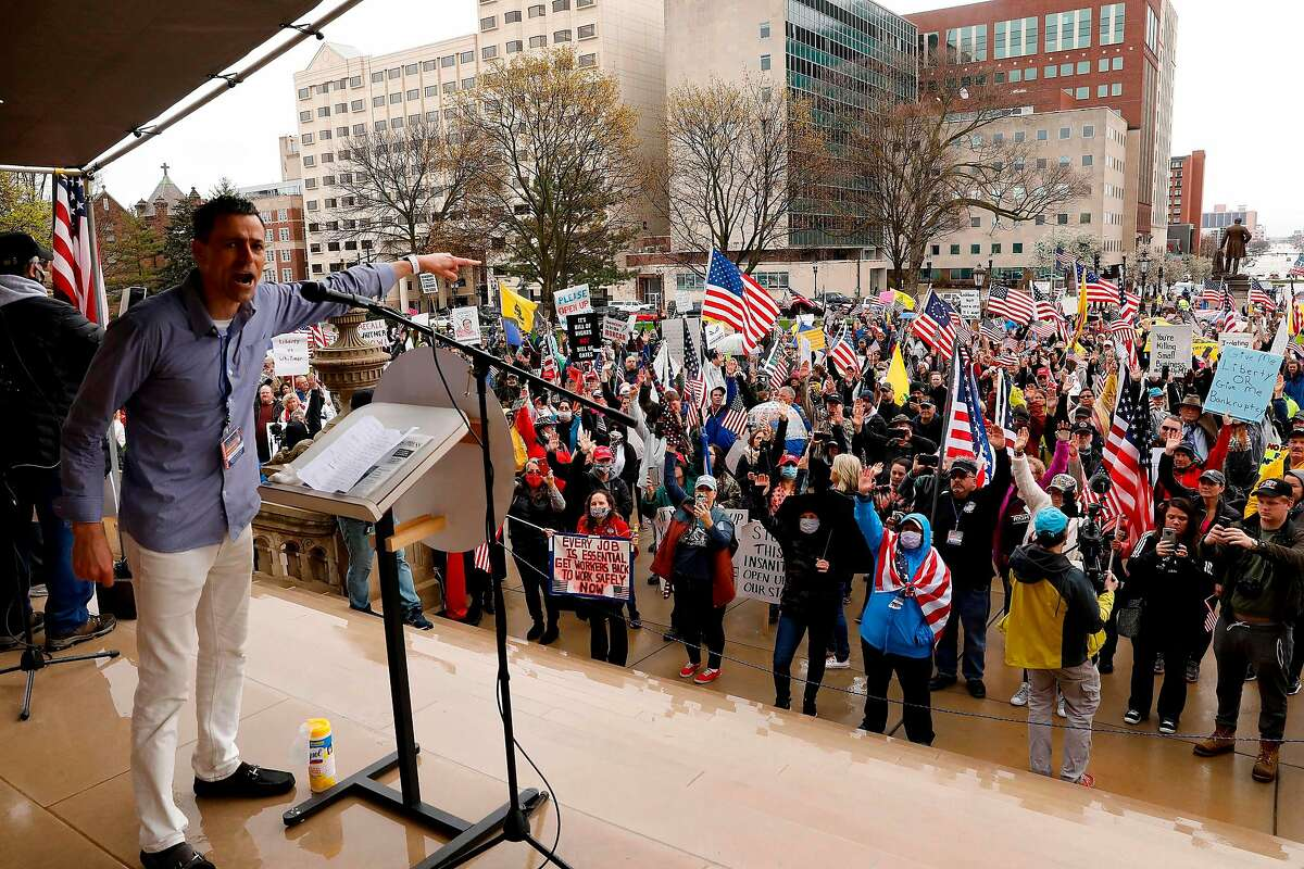 Ryan Kelley, a protest organizer, for the American Patriot Rally organized by the Michigan United for Liberty for the reopening of businesses stands on the steps of the Michigan State Capitol in Lansing, Michigan on April 30, 2020. - The group is upset with Michigan Gov. Gretchen Whitmer's mandatory closure to curtail Covid-19. (Photo by JEFF KOWALSKY / AFP) (Photo by JEFF KOWALSKY/AFP via Getty Images)