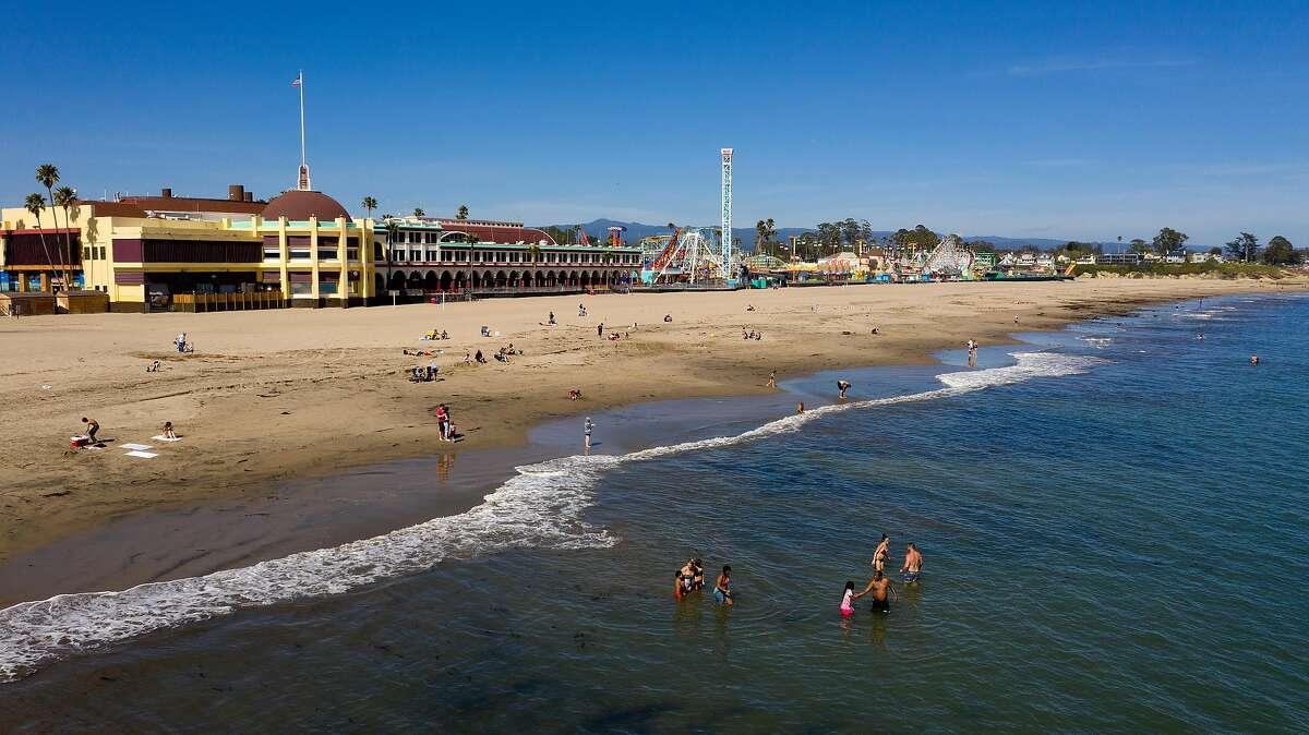 Bathers swim at Santa Cruz Beach on Wednesday, April 22, 2020 in Santa Cruz, Calif.