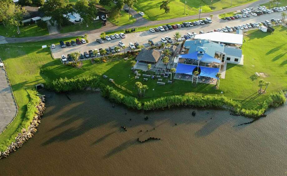 An aerial photo of Neches River near the Neches River Wheelhouse Wednesday evening. Port Neches will be working on its riverfront to prevent erosion by installing a bulkhead near the restaurant.  Photo taken on Wednesday, 07/24/19. Ryan Welch/The Enterprise Photo: Drone Image: Ryan Welch, Beuamont Enterprise / The Enterprise / ©Ryan Welch