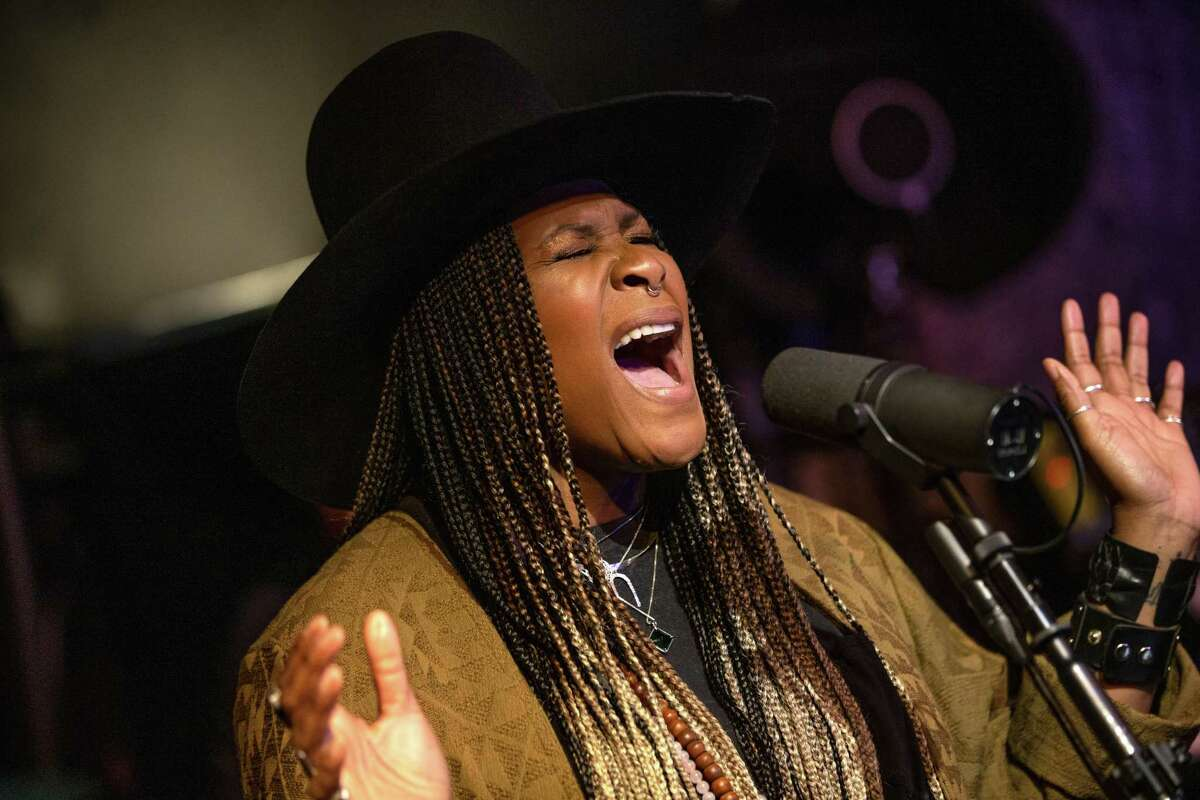 Musician and songwriter Tiffany Wilson performs during The Quarantine Sessions, a ticketed online event, at the House of Breaking Glass recording studio on March 29 in Shoreline, Washington. The Quarantine Sessions are a way for local musicians to perform online livestream concerts in high-quality audio.