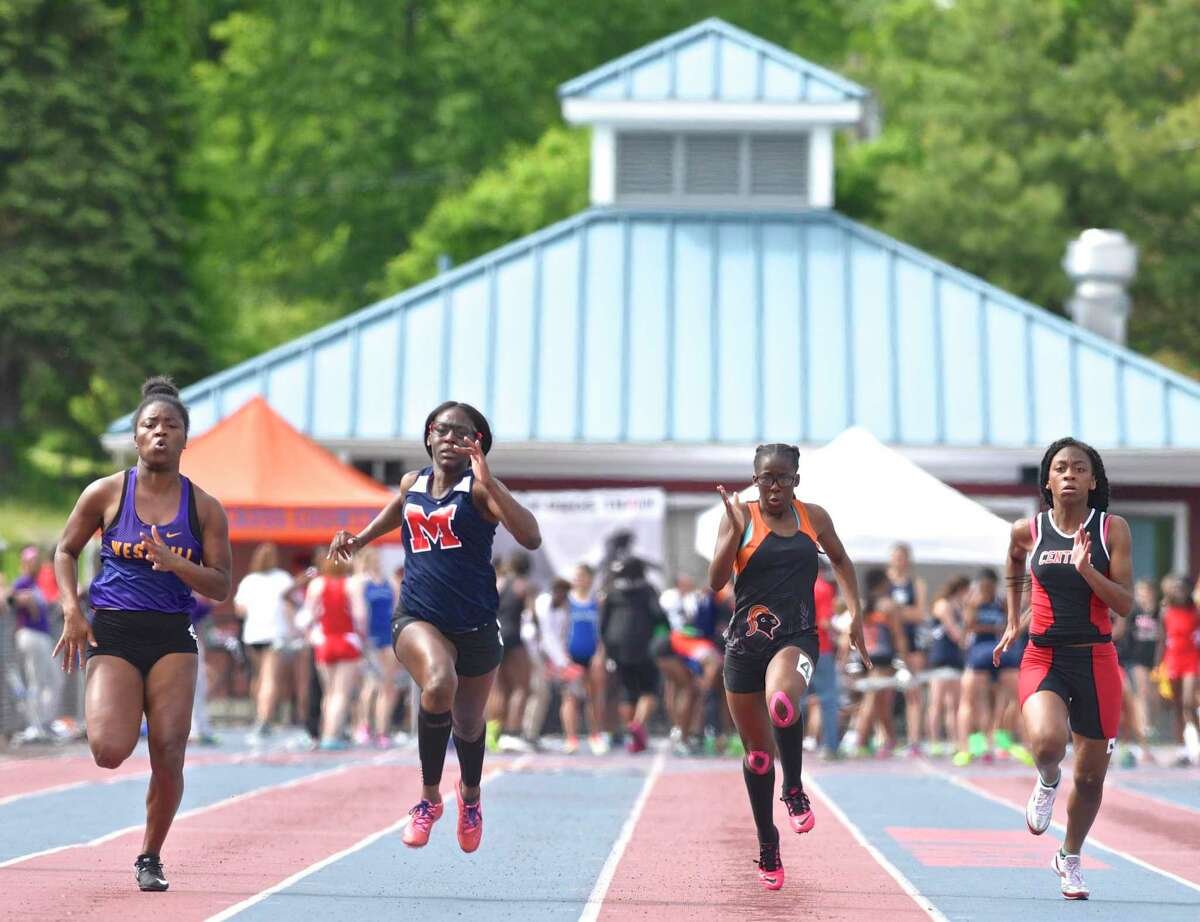 Westhill's Naike Lazarre, left, McMahon's Jazmin Bien-Aime, Stamford's Athalie Fils and Central's Najah Hunt compete in the 100-meter dash during the girls FCIAC track championships in 2017 in Danbury.